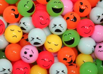 balls with faces showing various expressions