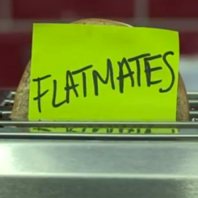 Sticky note attached to toast in toaster saying Flatmates