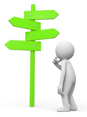 Simple figure looking at a signpost
