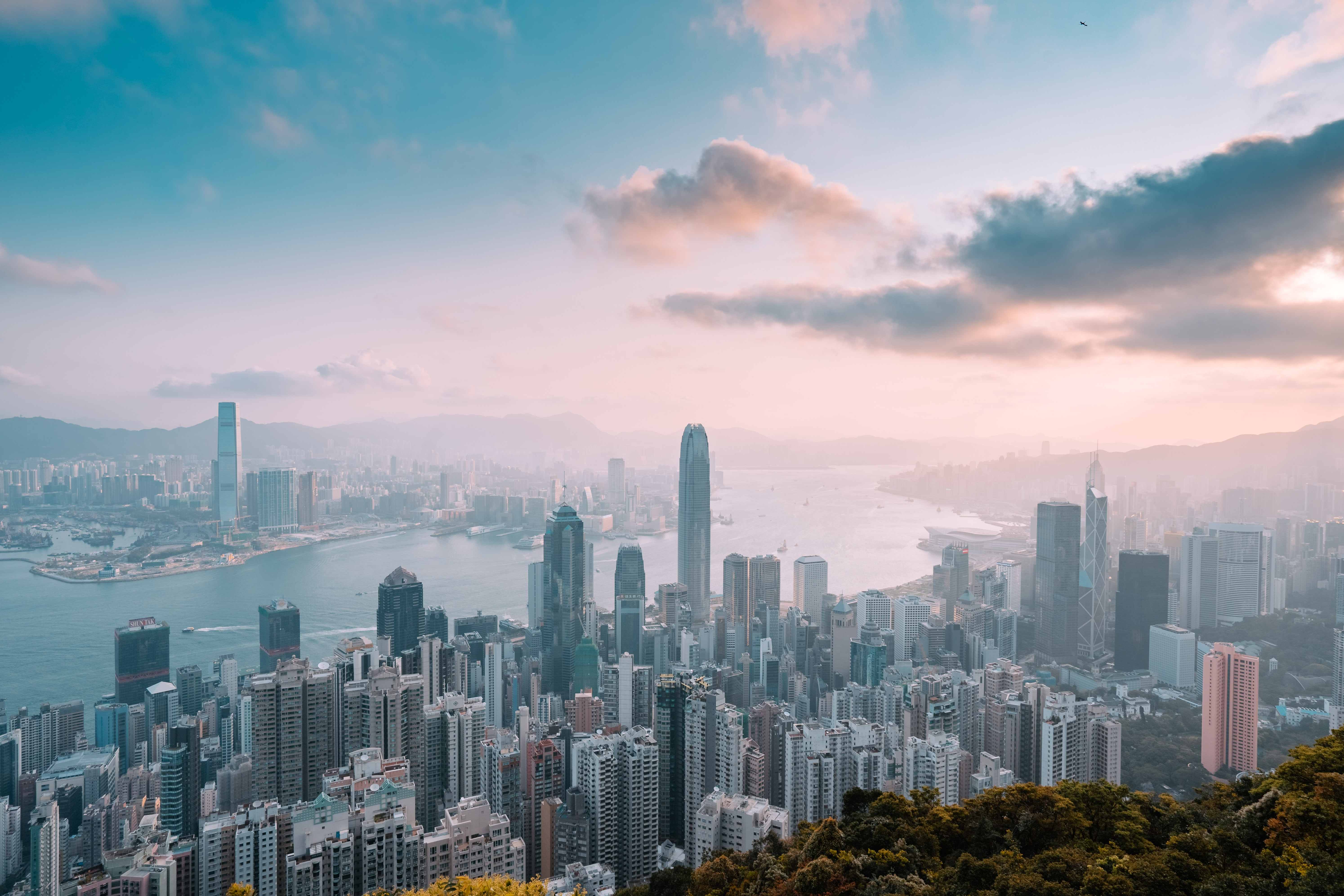 A stock photo of the Hong Kong skyline with an interesting blue and pink daytime sky