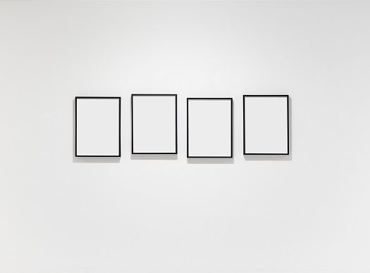 plain wall with four empty frames