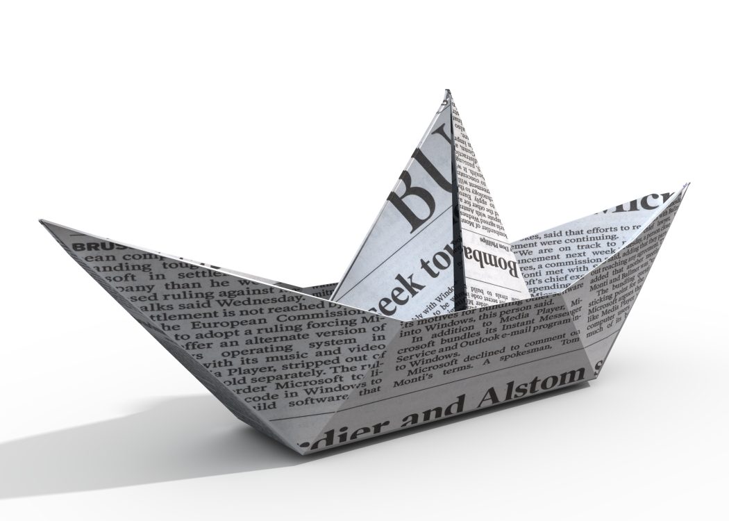 Newspaper folded in to origami boat shape