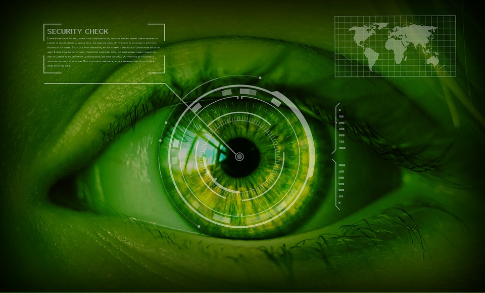 Image of green eye with data running through it.