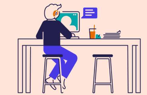 Person sitting at desk with computer