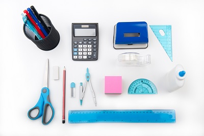 Photo of calculator, ruler, compass and other useful tools