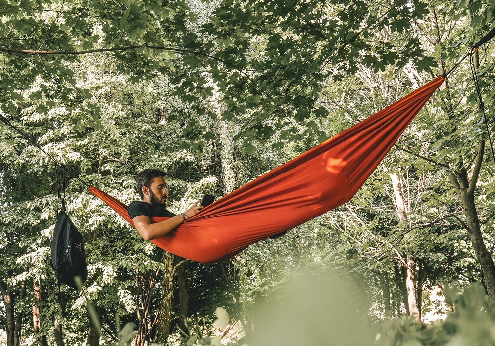 choose the best place to work like this man in a hammock in nature
