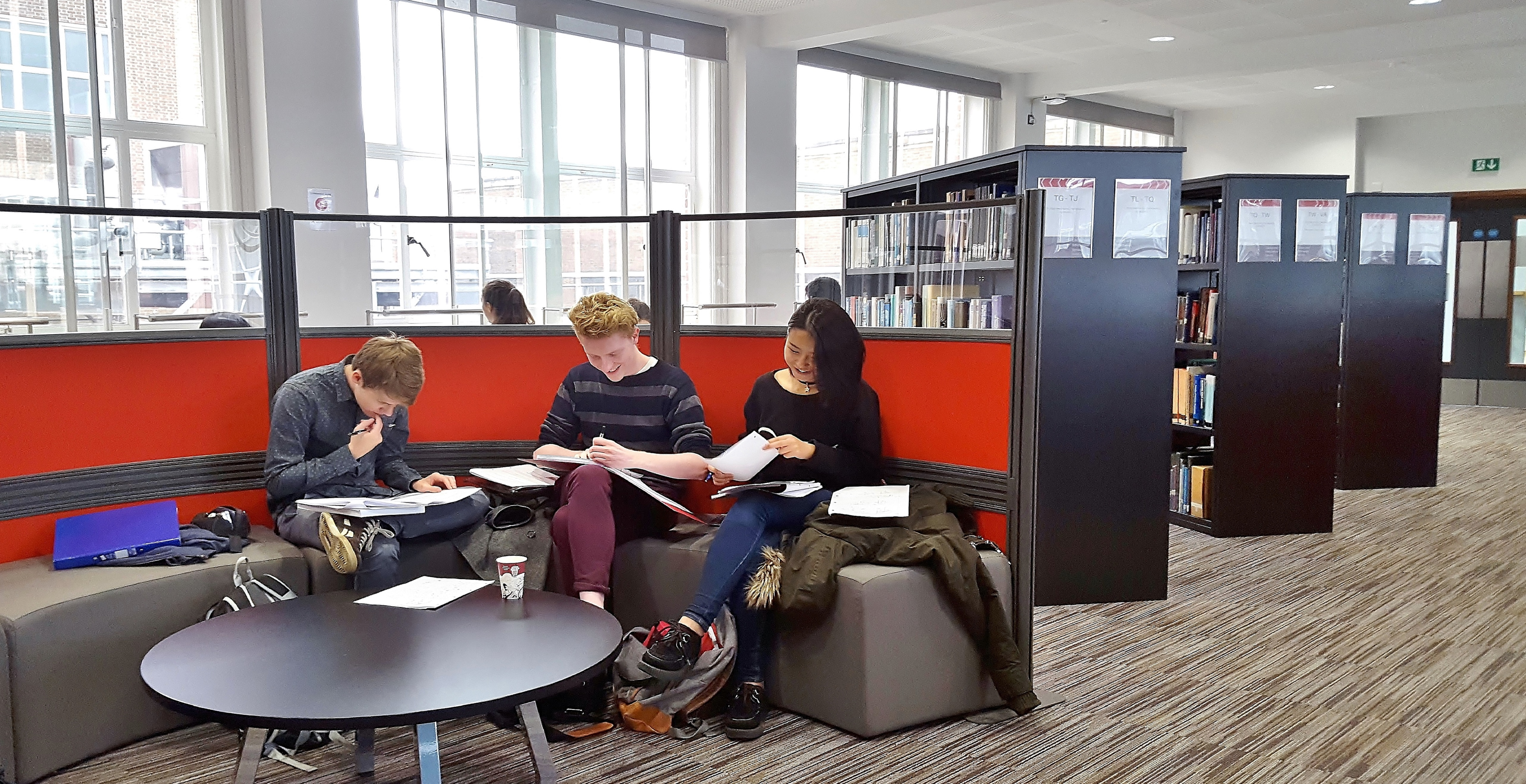 Students having a discussion in the library