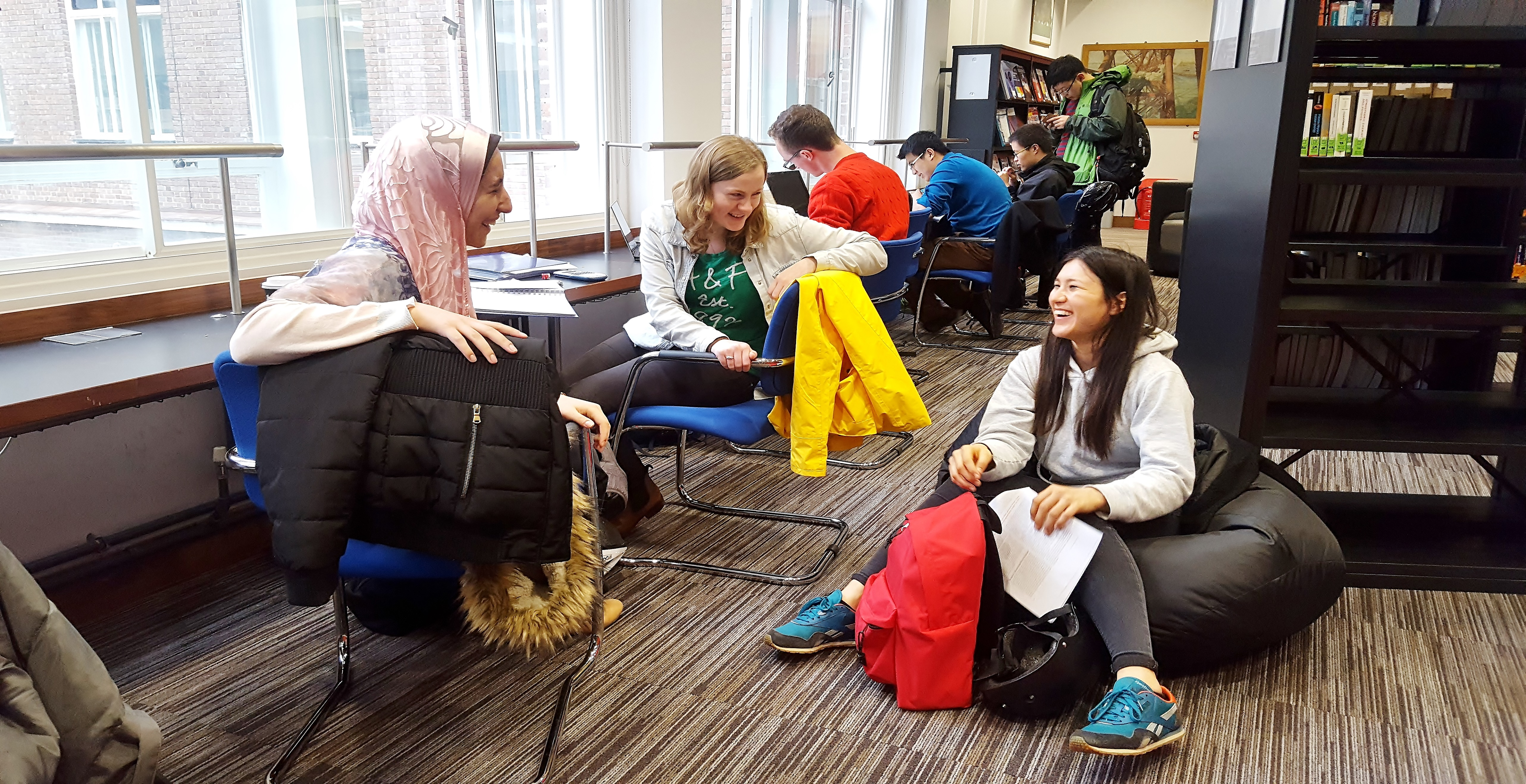 Students chatting in the library