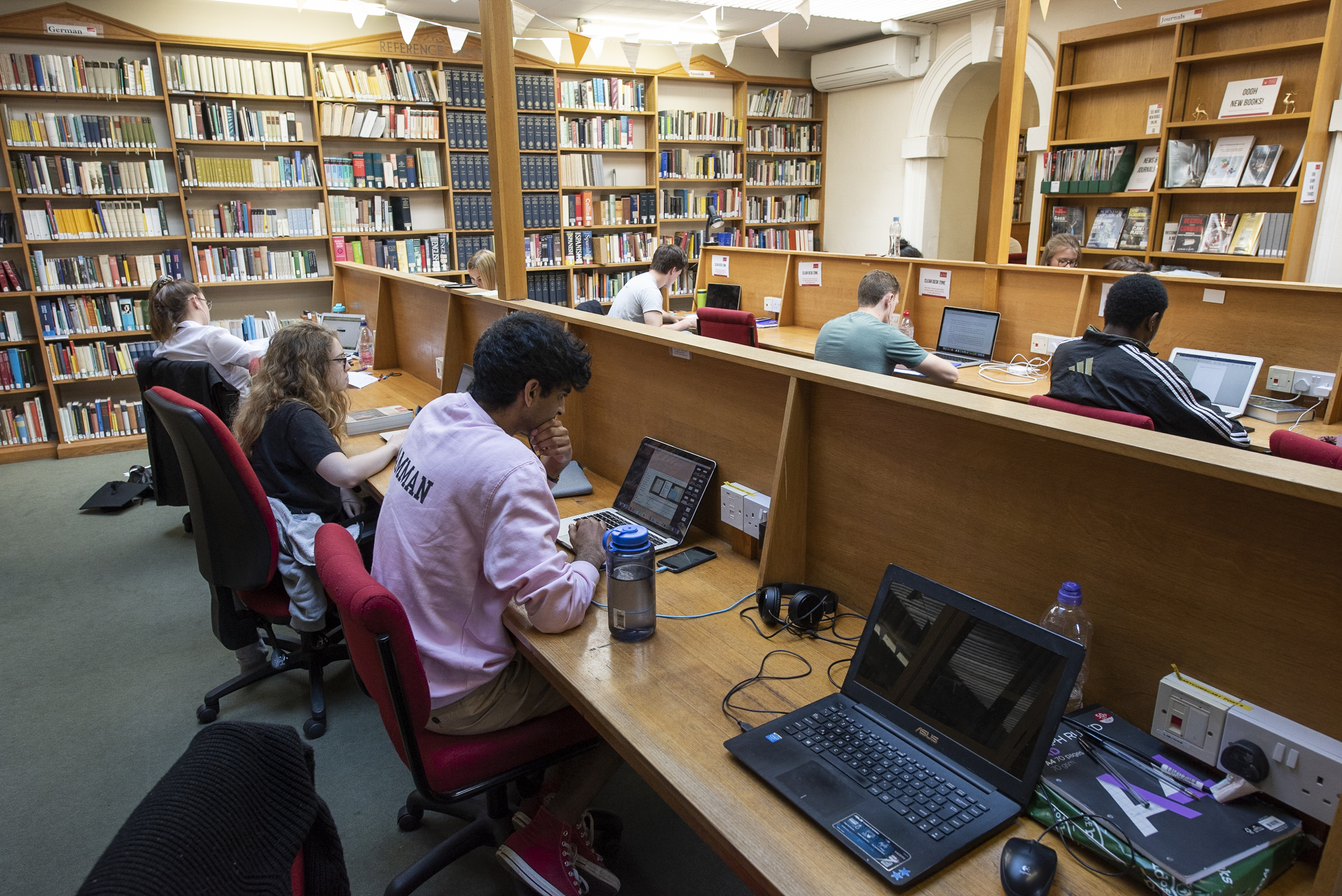 Hertford College Library reading room with students