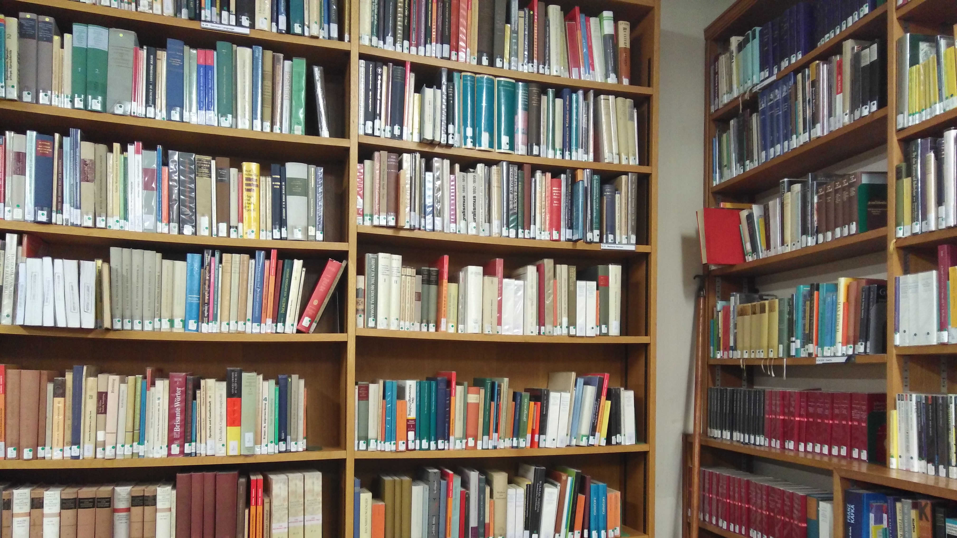 A book lined corner of Hertford Library's Upper Reading Room