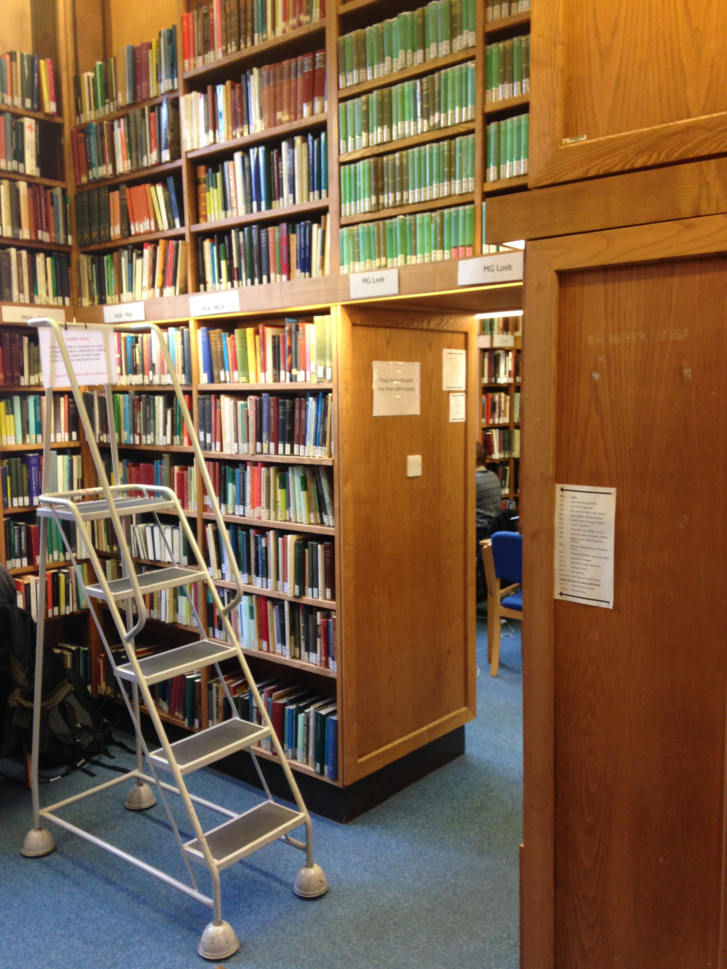 Book filled shelves in Jesus College Library