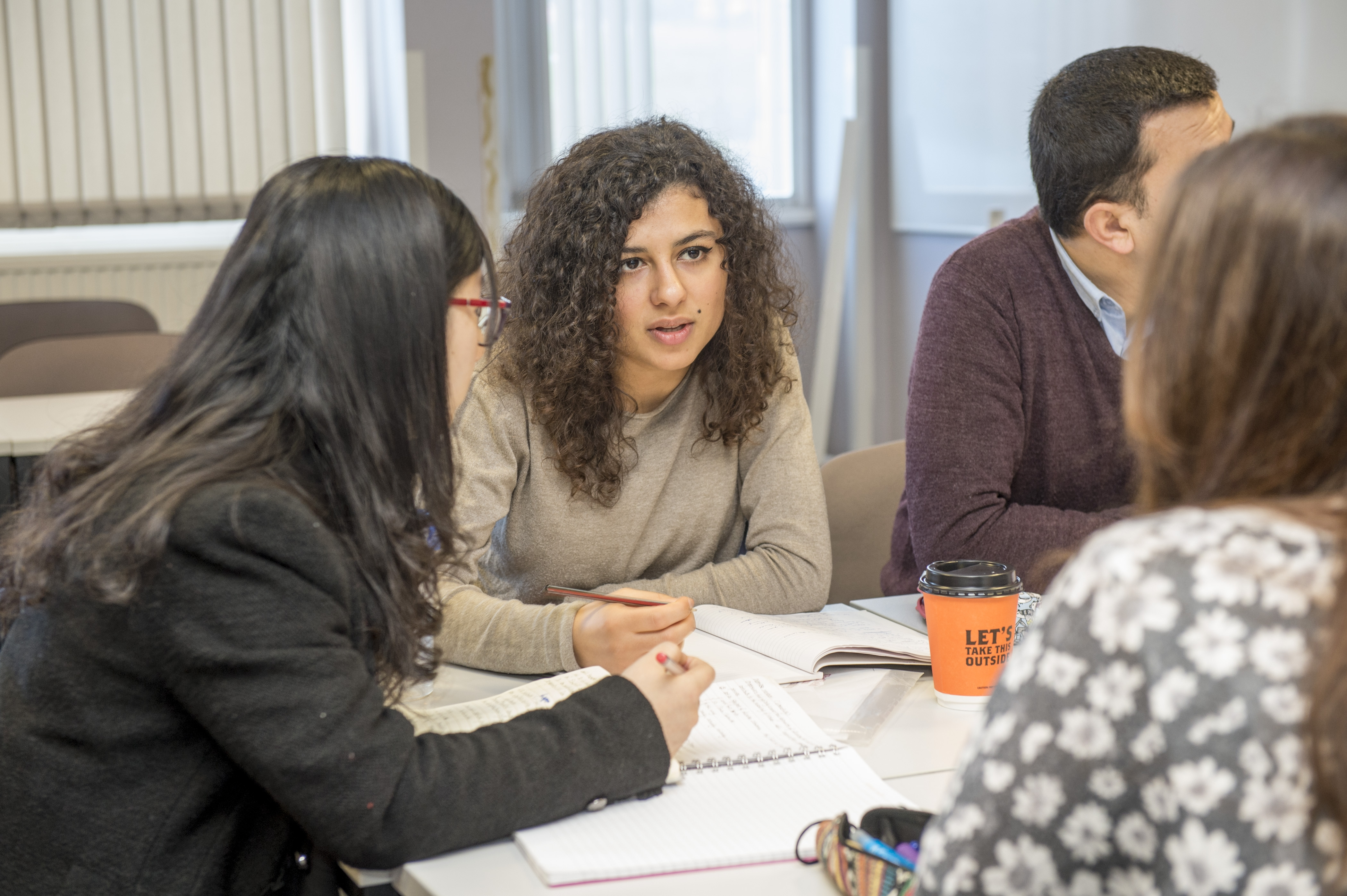 Students talking at a conversation club.
