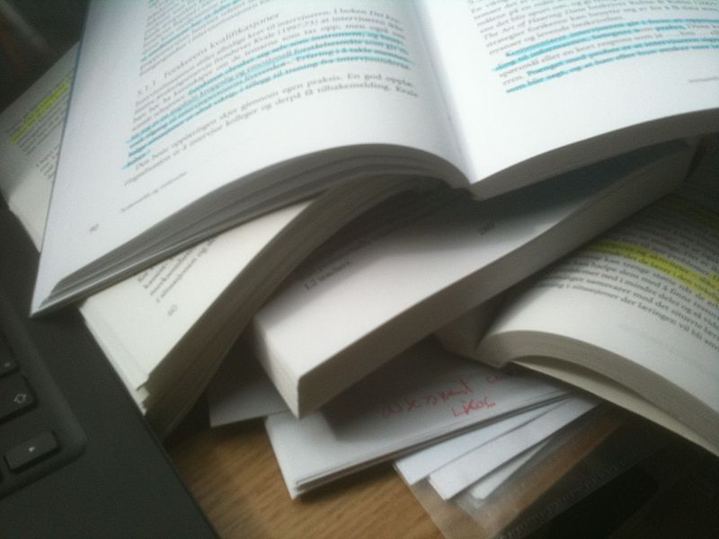 Stacks of books with annotations.