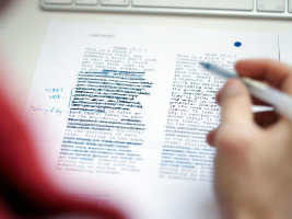 A student editing their work. Click for information on how to get feedback on your writing.