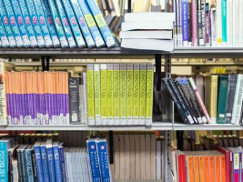 Textbooks on library shelves. Click for sessions on research and information skills.