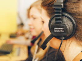 Students wearing headphones in a language lab.