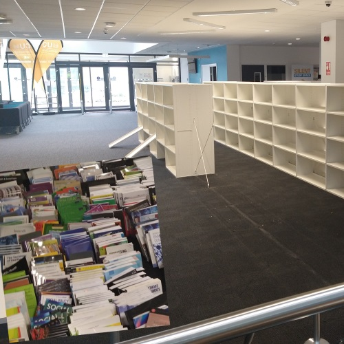 View of the old Library space with empty, half-dismantled shelving, with inset shot of books on floor