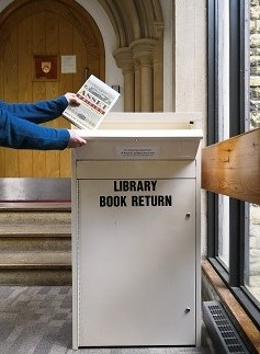 Library book return box in use