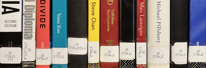 A photograph of books shelved using the Library of Congress system.