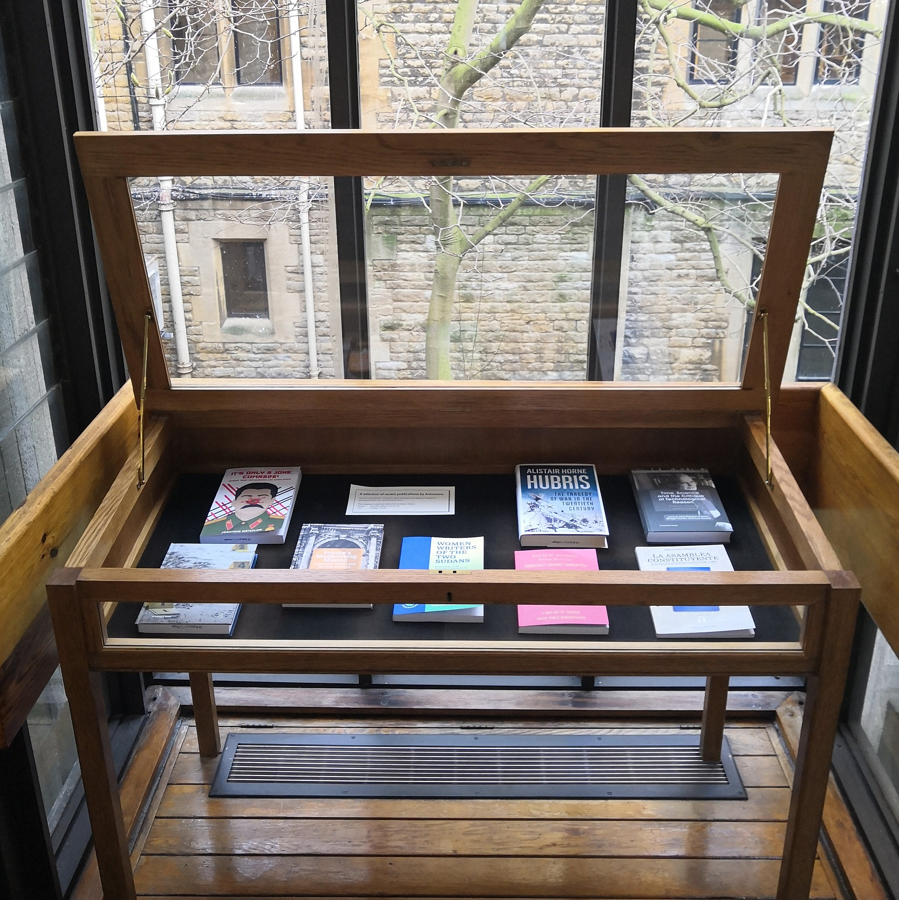 A photograph of the members' books display case.