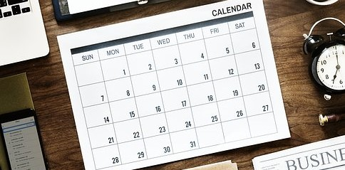 A photograph of a calendar. Remember your due dates!