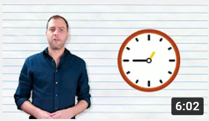 Adult man beside image of a clock.