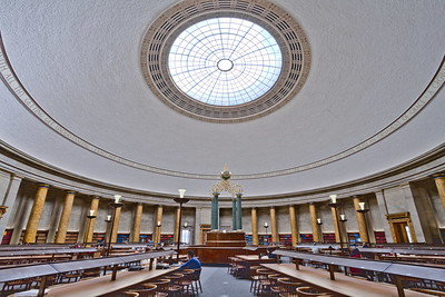 The interior of Manchester Central Library's reading room, featuring a grand domed ceiling