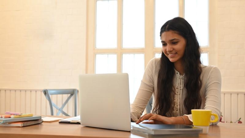Female student learning online