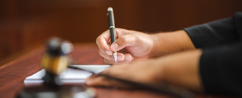 A close up of a judge making notes