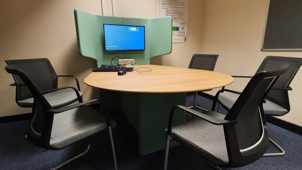 Library Group Room featuring chairs around a desk and PC screen