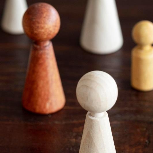 Unique wooden pieces on a board