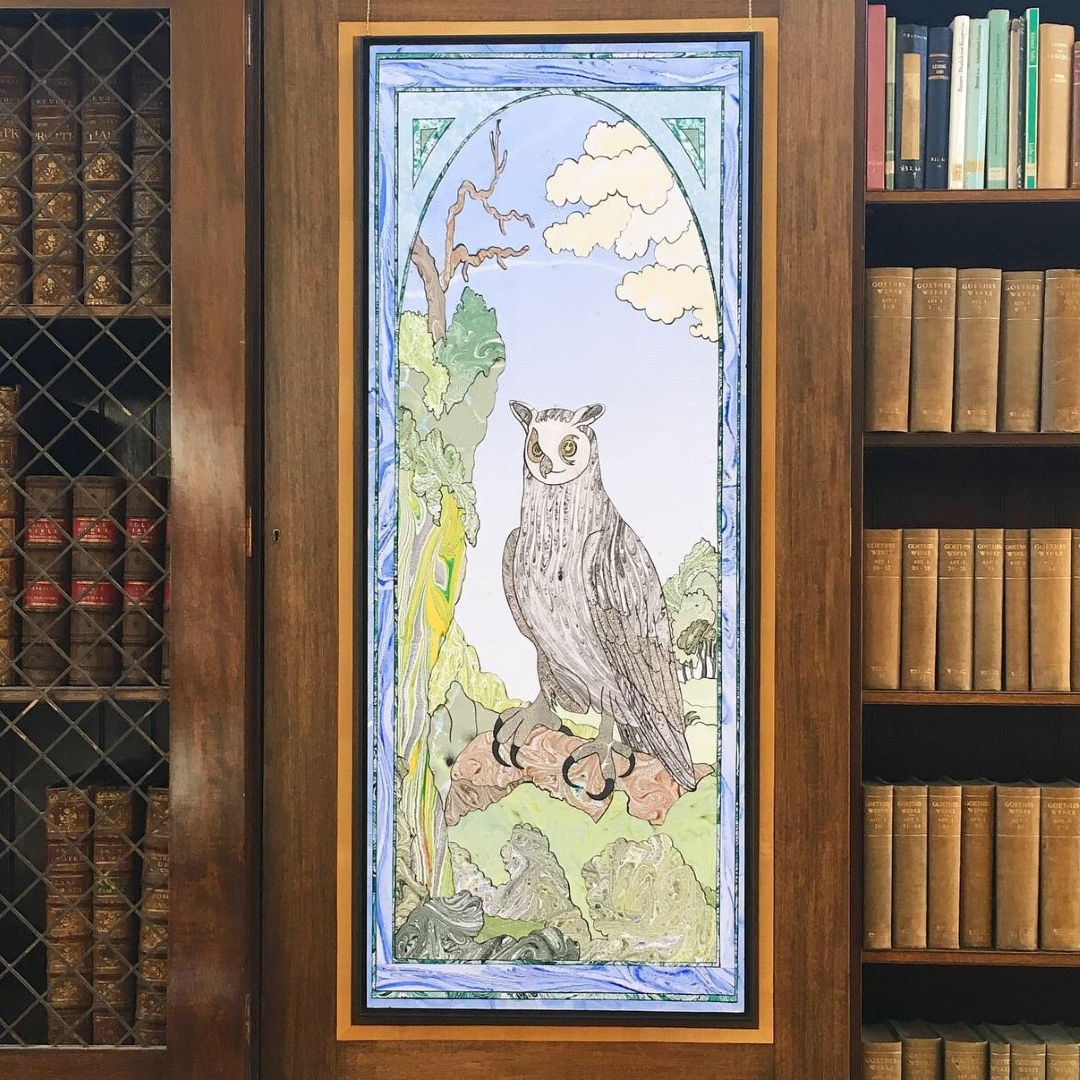 Artwork installed in LMH Library: marbled paper collage of an eagle owl.