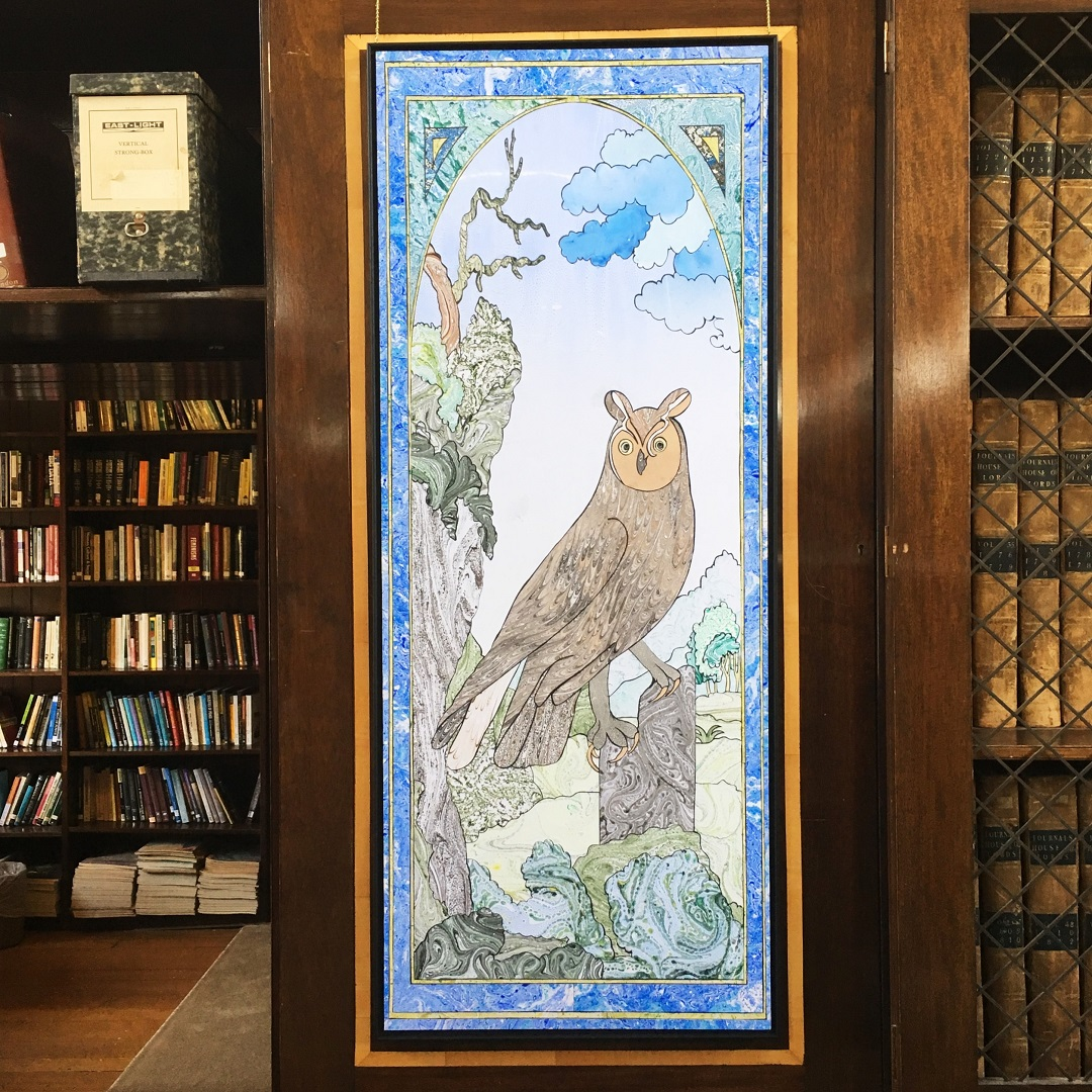 Artwork installed in LMH Library: marbled paper collage of a long-eared owl.