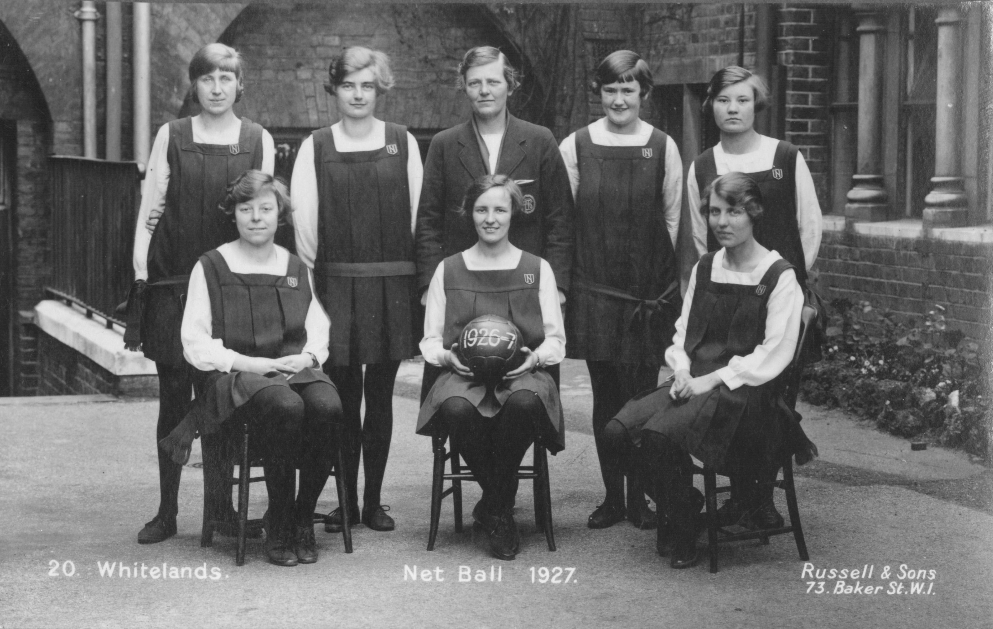 Photograph from Whitelands Archive: Net ball 1927; a team of 8, posing with a ball.