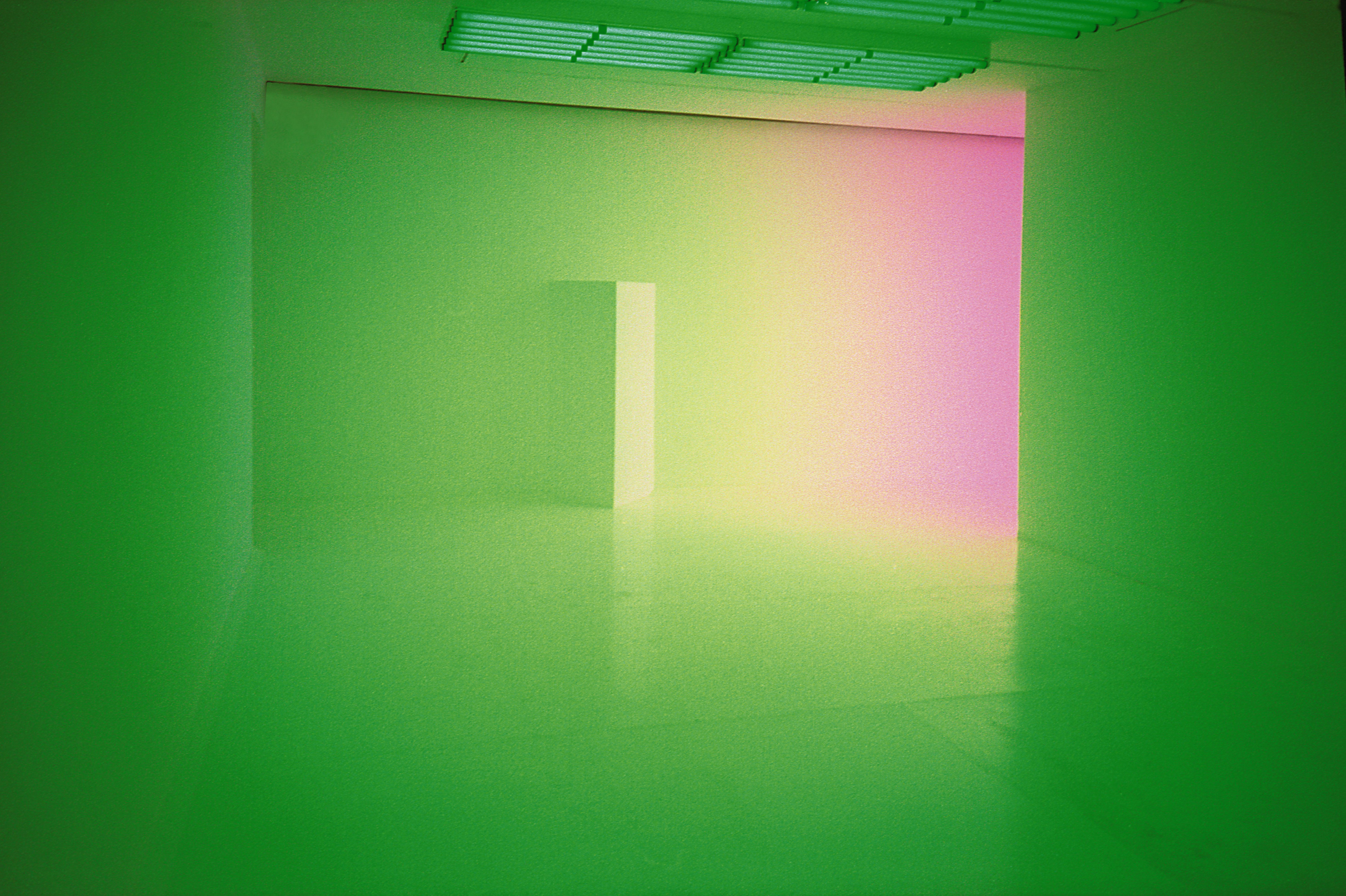 Image of a room with colourful lights in green and pink