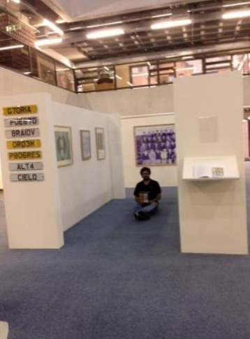Man sat on the floor in art gallery