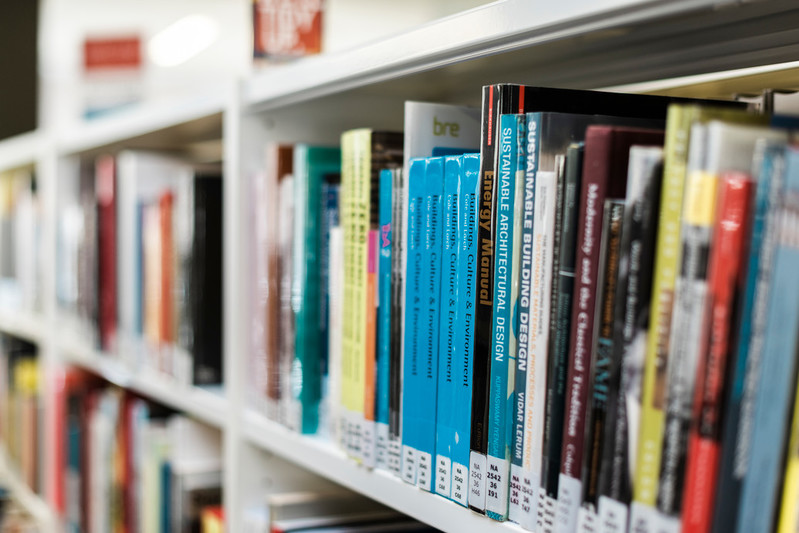 Books lined up on a library book shelf