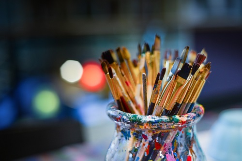 Photo of paint brushes (artists tools) in pot
