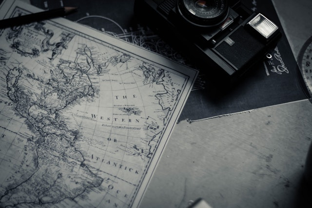 Map of the Americas with a camera on a table