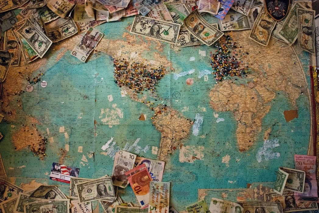 Photo of a map with currencies.