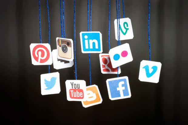 social media icons hanging from strings