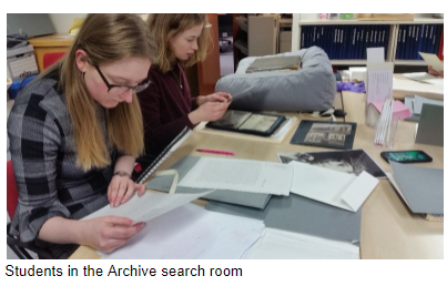 Students using resources in the archive search room