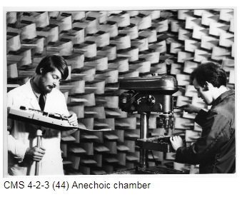 Two men working in an anechoic chamber