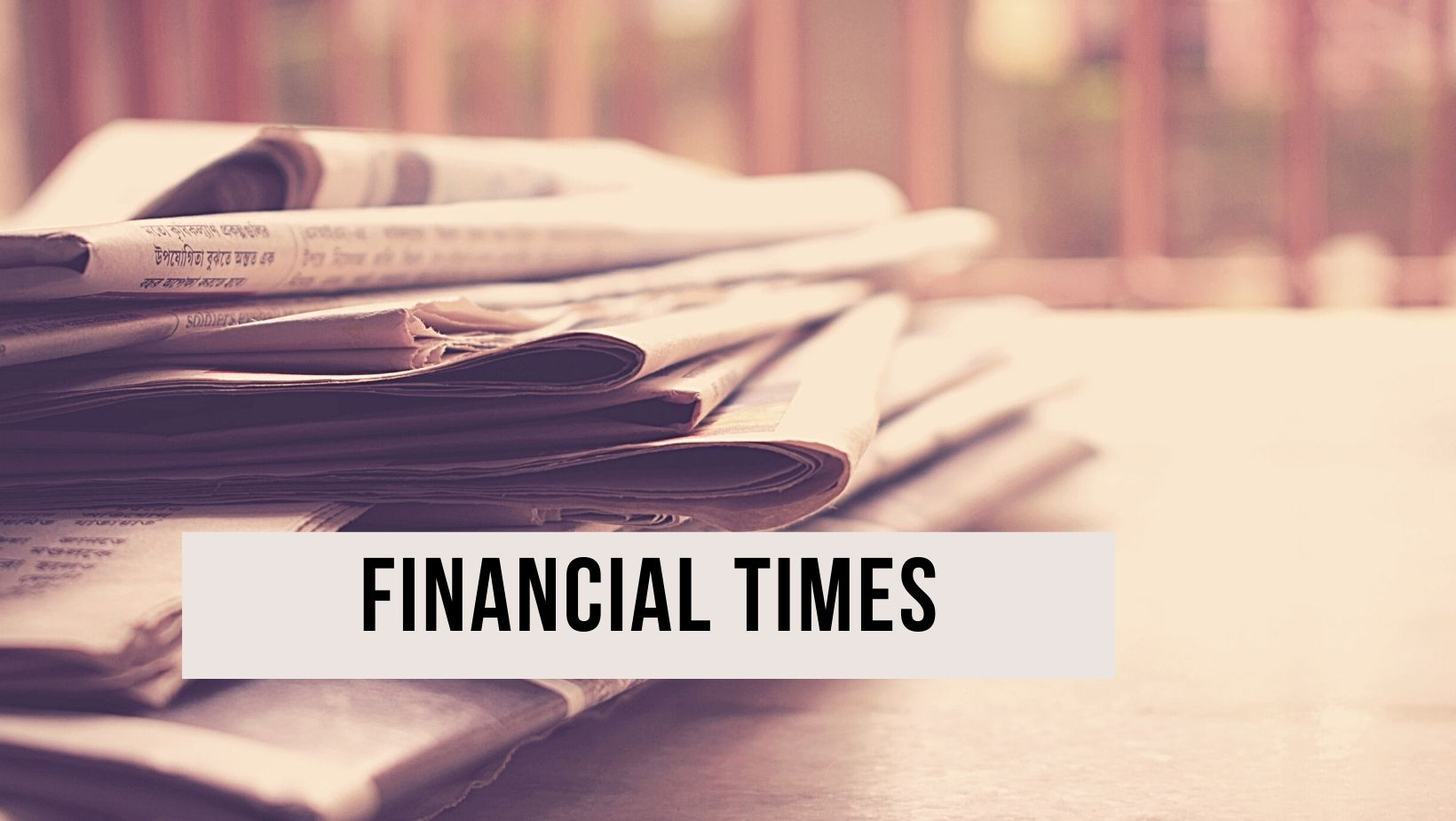 A picture of newspapers representing the financial times