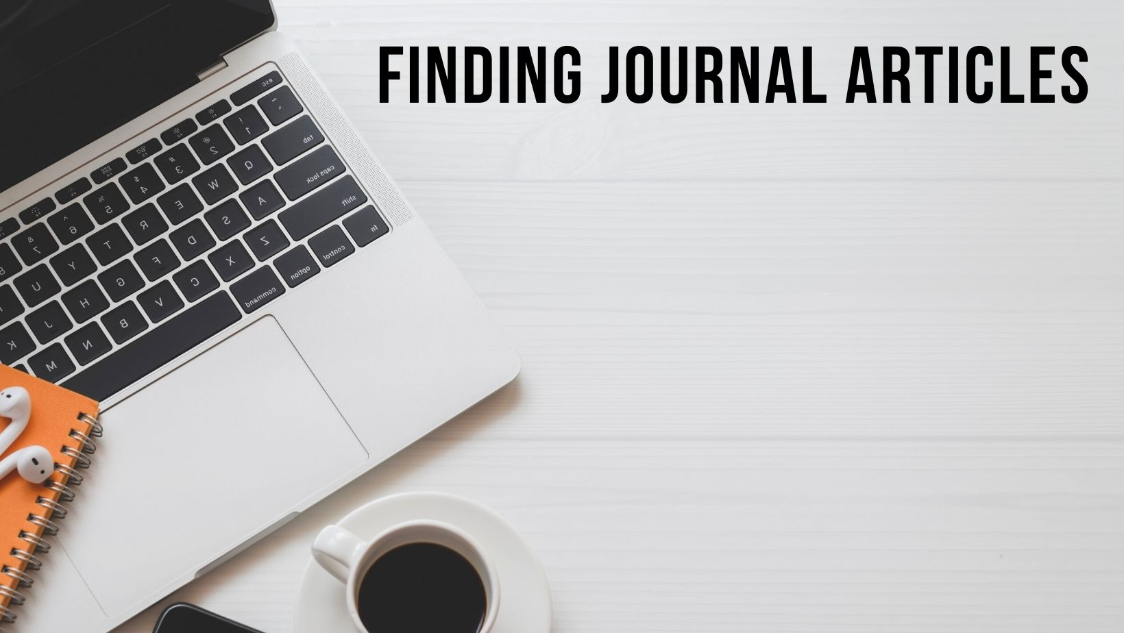 A picture of a laptop and notepad to show finding journal articles