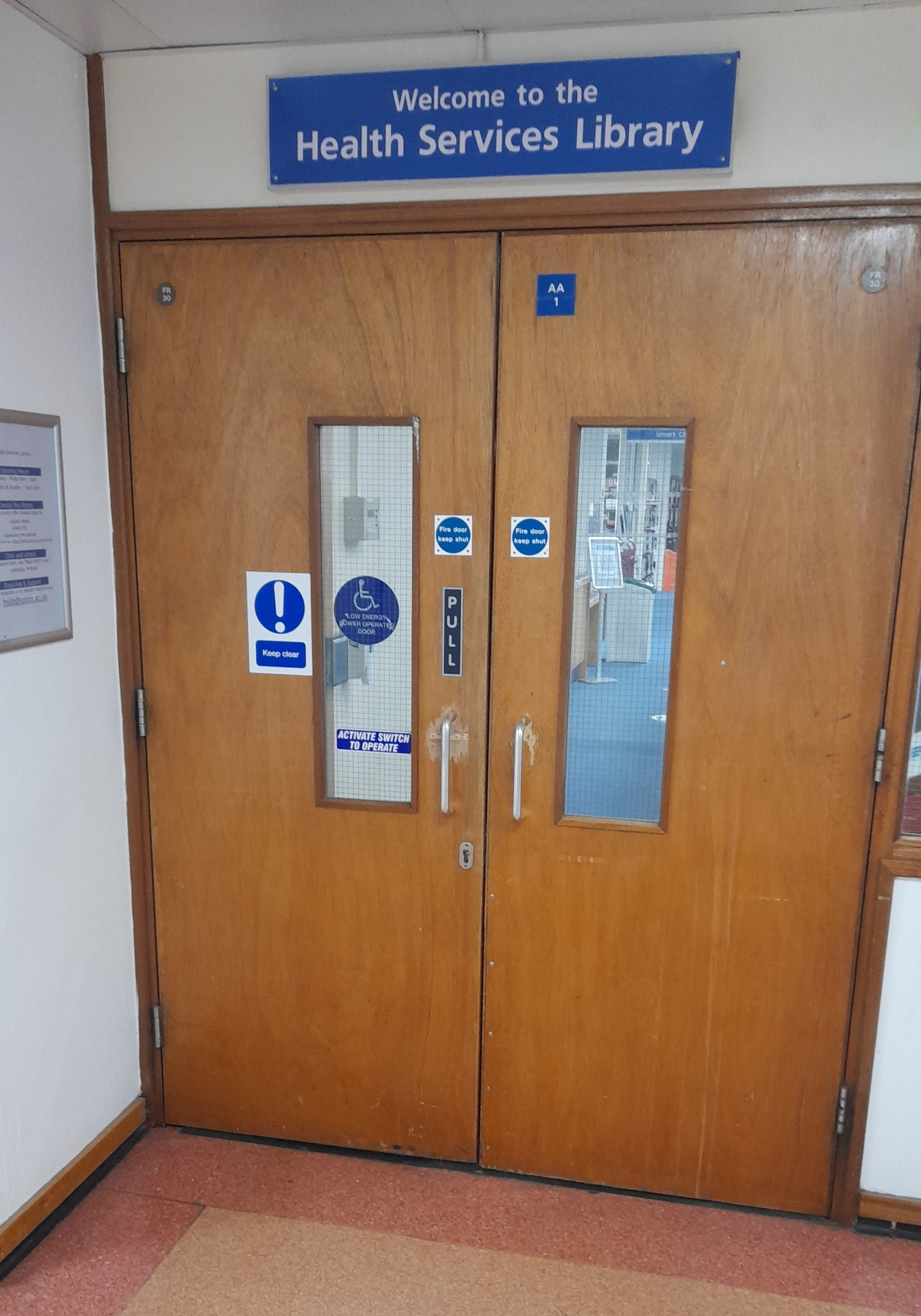 The double doors leading to the Health Services Library.