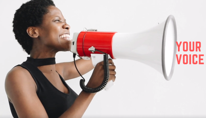 woman with loud speaker with 'your voice'