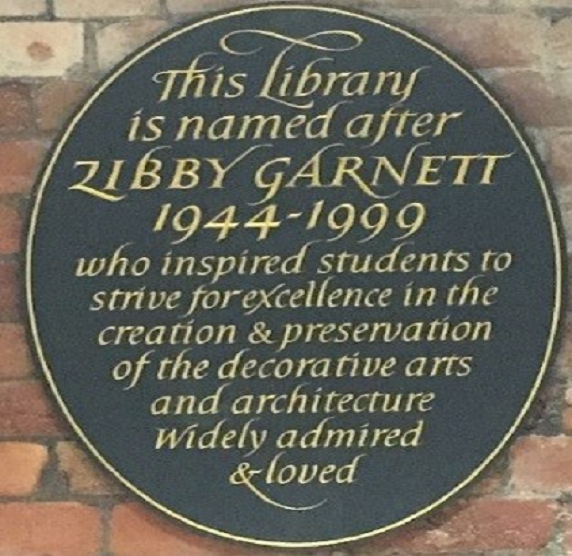 """Zibby Garnett plaque outside Zibby Garnett Library in the University Library reading """"This Library is named after Zibby Garnett (1944-1999) who inspired students to strive for excellence in the creation & presevation of the decorative arts and architecture. Widely admired & loved."""""""