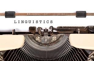 typewriter typing the word linguistics