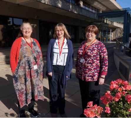A photograph of Vicki, Hilda and Sharon outside the Main Library.